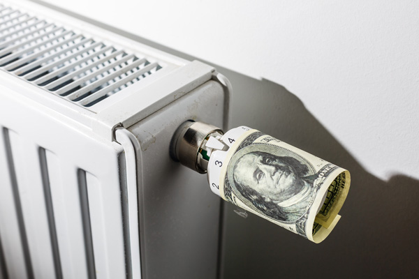 image of radiator with money and home heating costs