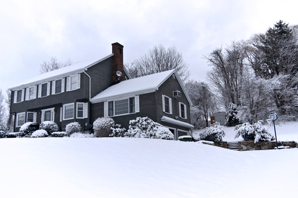 house in winter that uses heating oil